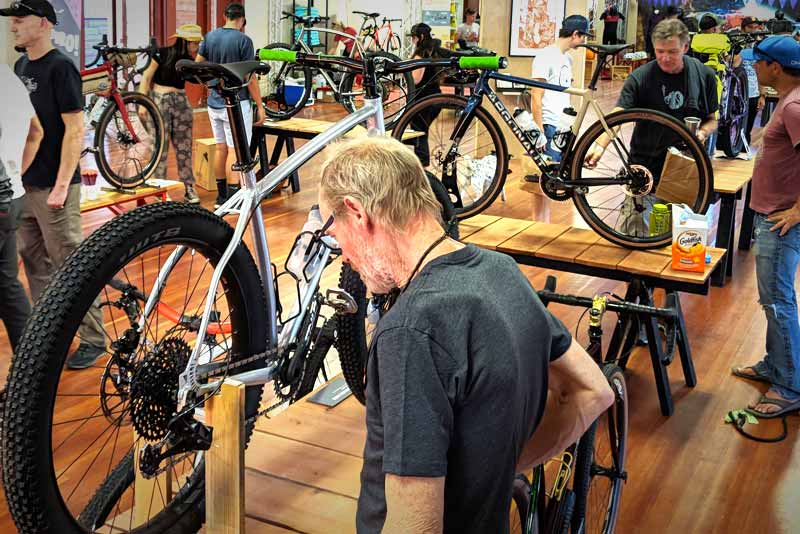 Man looking closely at handmade bike